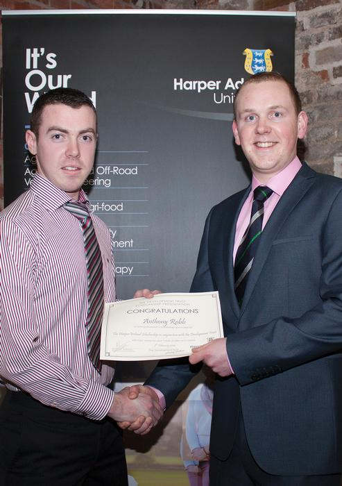 In one of his final duties as chairman, David Thornton awards a Harper Ireland scholarship to student Anthony Robb.