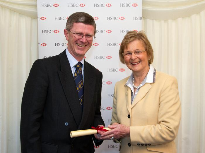Dr David Llewellyn receives the Associateship from Baroness Byford