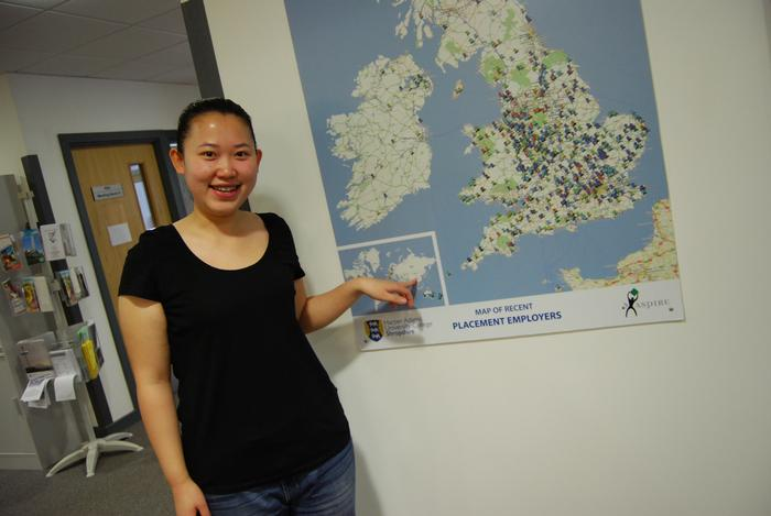 Joanna points out China on the map