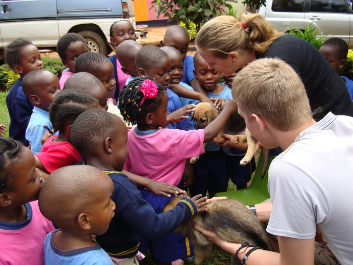Tanya shows a puppy to African school children