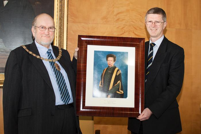 Council Leader Councillor Malcolm Pate receives the portrait from Harper Adams Chancellor, Dr David Llewellyn