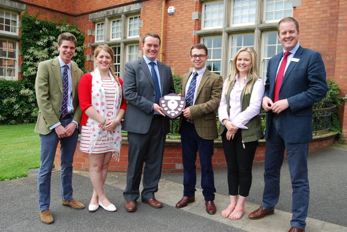 Steve Farrow presents the trophy to Alex Coles (centre), joined by Winston Churchill team members and lecturer Andrew Black (far right)