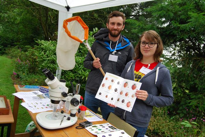 Joe Roberts and Alice Gribble manning a stand on the insect trail