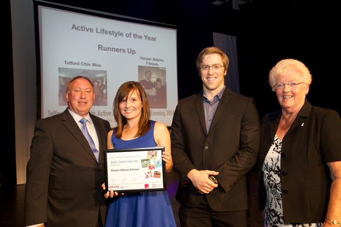 Ceri and Andy receive the runner-up award on behalf of the Harper Fitness team