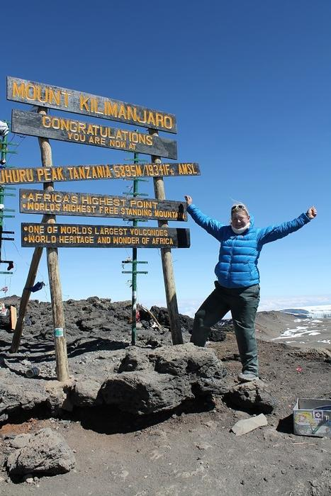 Amy at the summit of Mount Kilimanjaro