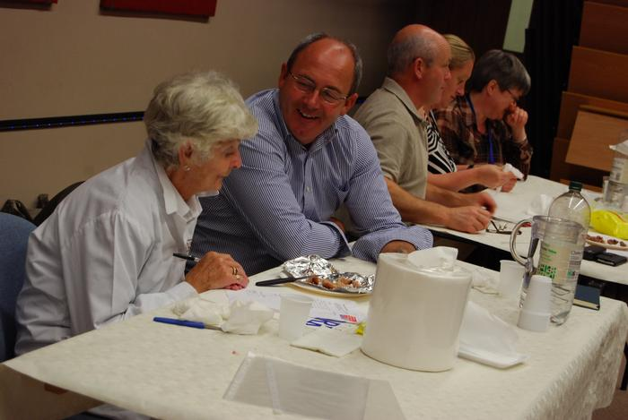 Lecturer Tony Asson (second from left) assists with the judging