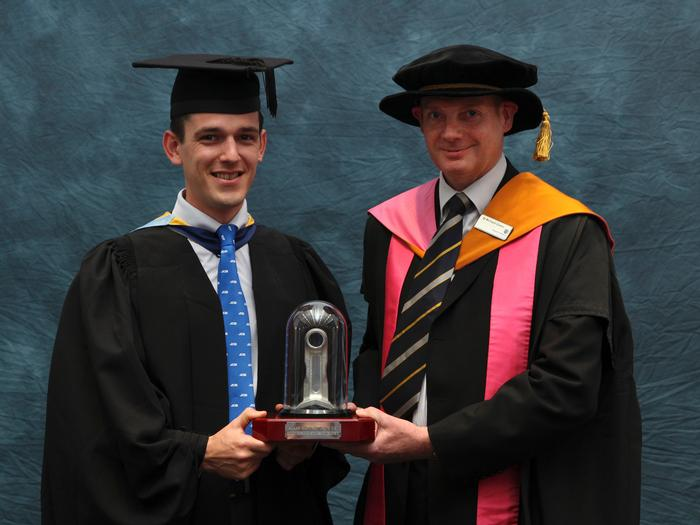 "Alex Skittery, 23, MEng Agricultural Engineering, from Little Marcle, Ledbury, Herefordshire, receives the Alamo Manufacturing Service Award from Senior Lecturer Dr Richard Green. Lecturer Greg Rowsell said: ""Alex graduated with distinction in his Masters degree and as the highest performing student of an exceptional cohort of Master of Engineering students. His final year individual Masters research project was: 'An investigation into the effect steering has on vehicle power consumption', which was successfully completed to a very high standard."