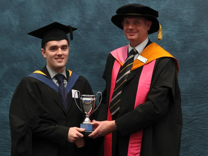 Andrew Plumb, FdSc Business Management with Marketing with Merit, receives the Bomford Prize from senior lecturer Dr Richard Green