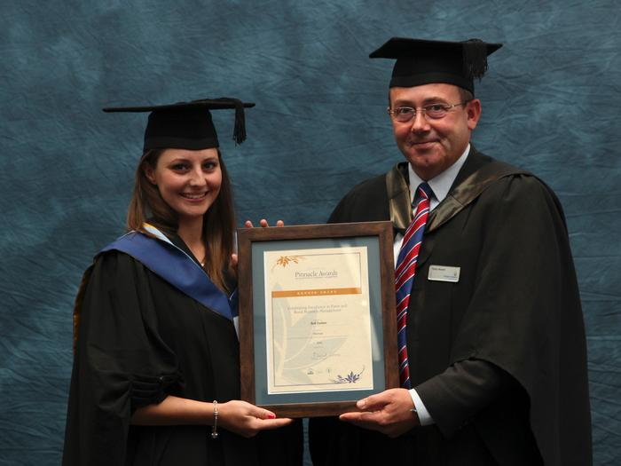 "Beth Duchesne, BSc (Hons) Agriculture with Farm Business Management, receives the Farmers' Club Pinnacle Award from Senior Lecturer Tony Asson, at the Harper Adams University graduation prize-giving. This award is given for excellence in business management. Students across the country submit work to the Farmers' Club on the recommendation of their tutors. The work is judged and short listed.  Mr Asson said: ""Beth's work was on a real-life upland organic farm in the Shropshire Hills, looking at an alternative income stream for the farmer. Time and other client-based constraints meant the diversification idea had to be in a growth market sector, low capital cost, financially sound and a low time input. The idea was to grow exotic mushrooms to sell to the catering and retail markets. Her work was judged at the finals in London and was awarded a Bronze award and a substantial cash prize. Beth graduates with a 2.1"" Beth, 22, comes from from Bury St. Edmunds, Suffolk"