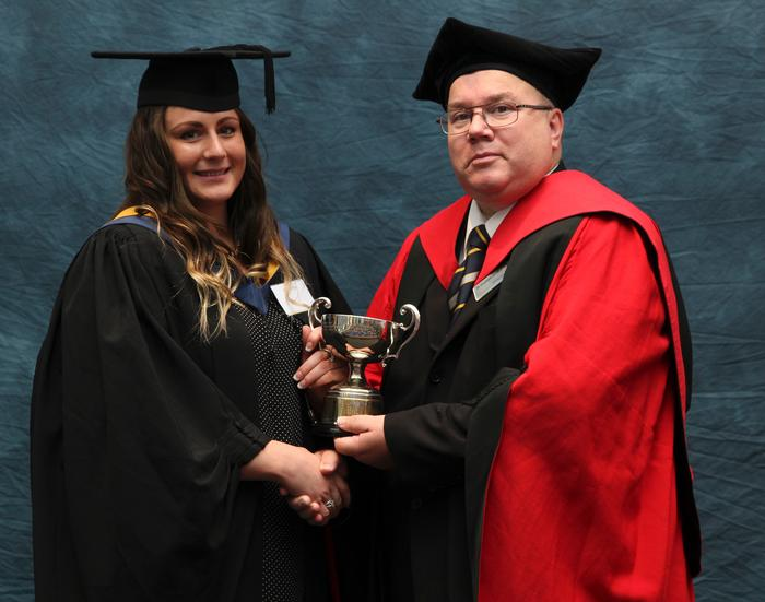 Charlotte Wright receives the Axworthy Cup and Robin Faccenda Prize from Senior Lecturer Dr Graham Scott, for achieving the top marks in practical and written work during placement year in the poultry industry
