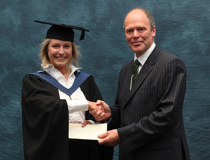 Georgina Parry, BSc (Hons) Rural Enterprise and Land Management, receives the Central Association of Agricultural Valuers prize from external professional examiner Charles Meynell. This undergraduate award was presented at Harper Adams University's graduation prize-giving after Georgina achieved the top mark in the final year module 'Revenue Law and Statutory Valuation'. Georgina, 22, from Knighton, Powys, completed her placement year with Savills in Nottingham. She also received the MFG Solicitors Trophy, presented by Michael Payne, from MFG Telford, for obtaining the highest mark in Business, Residential, Tenancies and Land Law module – an apt award because Georgina is now working towards a Graduate Diploma in Law at Cardiff University Law School, with a view to becoming a solicitor.