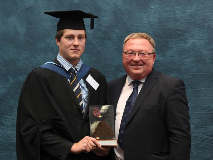 Henry Waight, BSc (Hons) Agriculture, receives the British Society for Soil Science prize from Ian Brown on graduation day at Harper Adams University, Shropshire. This award is made annually to the student achieving the highest mark on a final year dissertation on a soils related topic.
