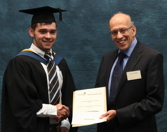 James John Phillips, FdSc Agricultural Engineering, receives the Douglas Bomford Trust Prize from Professor Paul Miller, secretary of the Douglas Bomford Trust. This award is given annually at the Harper Adams University graduation to the best FdSc Agricultural Engineering student.