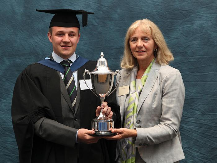 Michael Murphy, BSc(Hons) Agricultural Engineering with Marketing and Management, recieves the Claas (UK) Trophy from Jane Broomhall, CLAAS Personnel Manager. This award is made annually at graduation to best BSc/BSc (Hons) Agricultural Engineering with Marketing and Management Student at Harper Adams University, Shropshire.