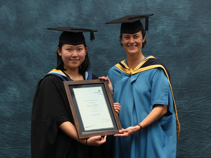 Pengwei Shan receives a BAC Food Quality with Retail Management Student of the Year Award from International Student Support Manager Jo Rawlinson