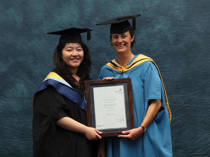 Pengyu Miao receives the BAC international business Student of the Year Award from International Student Support Manager Jo Rawlinson