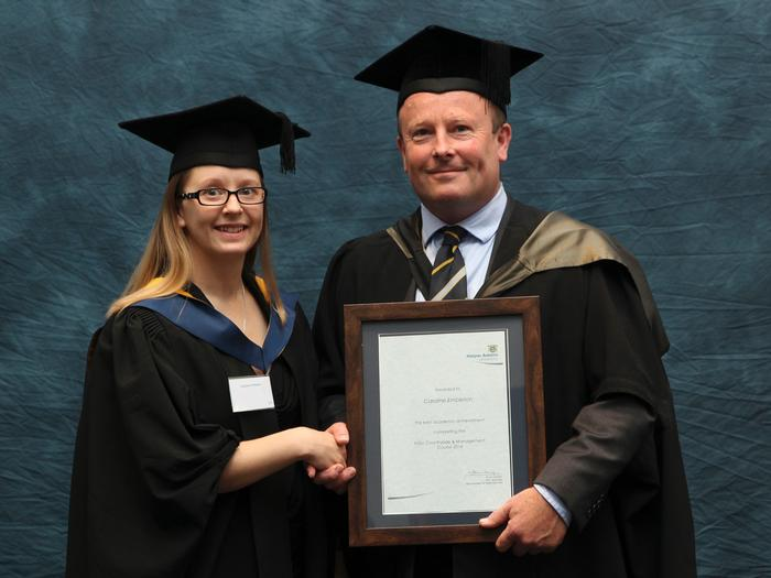"The FdSc Countryside Management Excellent Achievement award is presented to recent Harper Adams University graduate Caroline Embleton, 36, from Telford, by programme manager Simon Irvin. Mr Irvin said: ""Caroline is a worthy winner for the Excellent Achievement Award. Throughout her studies Caroline has applied herself with a dedication and commitment second to none, to become the top foundation degree student!"""