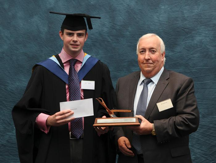 Andrew Dawson, BSc (Hons) Agrcultural Engineering, receives the John Deere Trophy from Gordon Day, who has just retired from his position as John Deere Marketing Manager (at the end of September 2014). The prize was presented at the Harper Adams University graduation prizegiving in September and honours Andrew as the best student on a BSc Agricultural Engineering Degree Programme. He graduated with first class honours and joins CNH as a graduate engineer.