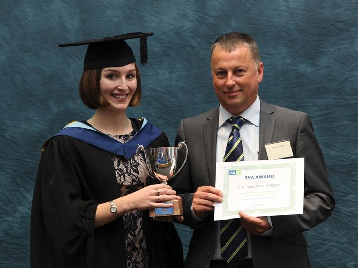 "Anna Holdcroft, 22, from Stafford, receives the ISA Award from Peter Cumbers, ISA Poultry Services, for submitting the best report in the final year assignment ""Intensive Husbandry Systems – Poultry"", in which she investigated important current issues affecting the UK and Global poultry industry."