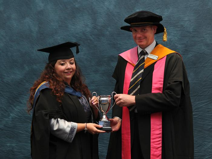 Beth Bason, BSc (Hons) Countryside Management, receives the Twose Prize from Senior Lecturer Dr Richard Green. The prize, presented at the Harper Adams University graduation prize-giving, recognises the best improvement in achievement during the course of countryside degree programmes.