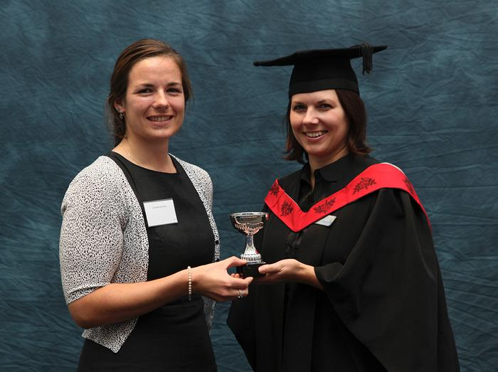 Caroline Bromley, BSc (Hons) Veterinary Nursing (with advanced standing), receives the Merial Award, for the best Diploma Advanced Veterinary Nursing student, from lecturer Nina Tudor.