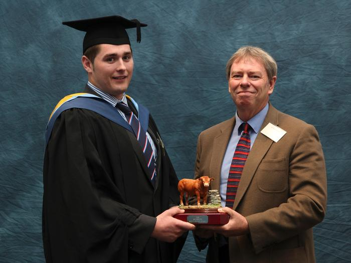 Drew Patrick, 22, BSc (Hons) Agriculture, accepts the Rumenco Beef and Sheep Award from David Thornton, Rumenco Technical Manager, in recognition of the quality of his assignment 'Beef & Sheep Enterprise Appraisal of Holdgate Hall at Much Wenlock'. Drew comes from a family farm in Haverfordwest, Pembrokeshire. Livestock at the home farm includes a herd of pedigree Charolais Cattle (Easthook) and Drew is secretary of the Welsh Charolais Cattle Breeders Club. Following completion of his studies Drew commenced employment in August with ABP as a graduate trainee manager based at Ellesmere.