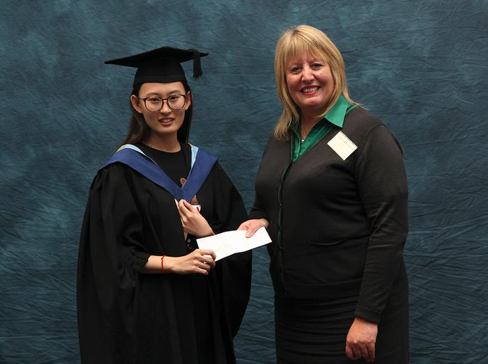 Lingchen Geng, BSc (Hons) Food Quality with Retail Management, receives the Lloyds Bank (Local Branch) Prize from Deborah Sutherland