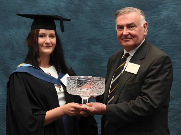 "The Taylor McNally Foundation Award is presented to Olivia Thorn, FdSc Animal Management and Welfare, by foundation secretary Basil Bayne at the Harper Adams University graduation prize-giving. Olivia, 22, from Winchester, Hampshire, receives the award for the high quality of her poultry project report. Dr Graham Scott said: ""Olivia presented an excellent project report which was of a very high standard. She researched the flooring preference of laying hens for nesting sites. She planned, executed and analysed her work to a very high standard."""