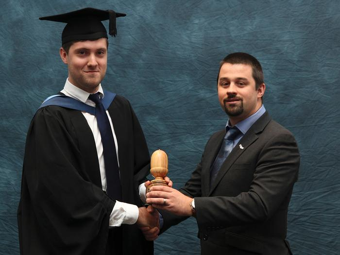 "The UPM Tilhill Ltd prize is presented to Richard Tallents BSc (Hons) Countryside and Environmental Management, from Tilhill Regional Harvesting Manager Iwan Williams, at the Harper Adams University graduation prize-giving. The award recognises the best final year student studying modules ""sustainable forestry"" and ""forest products""."