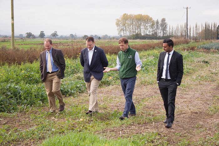 The visitors discuss crops research with Principal Lecturer Dr Jim Monaghan