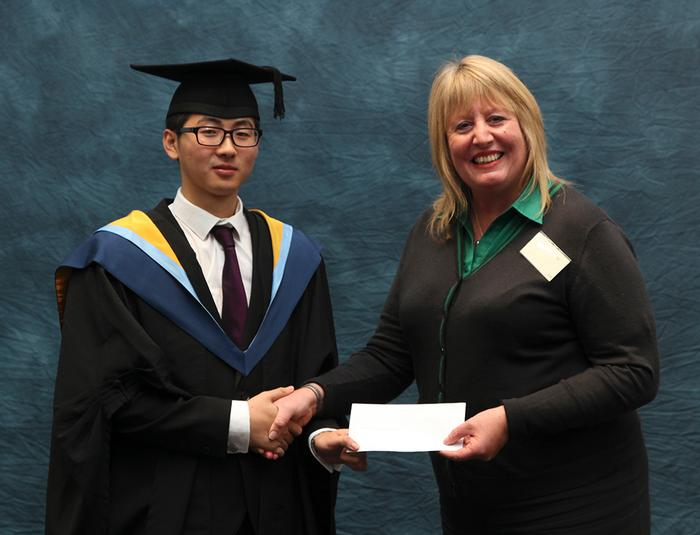 Yinong Zhang, BSc (hons) International Business Management, receives the Lloyds Bank (Local Branch) Prize from Deborah Sutherland