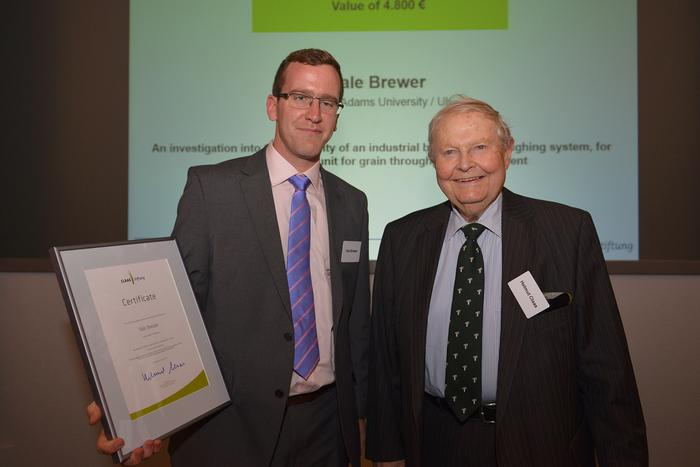 Yale Brewer receives his award from Helmut Claas