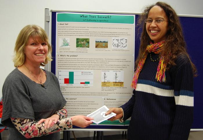 Dr Randall (L) presents Dr Graceson with her prize for producing the best poster