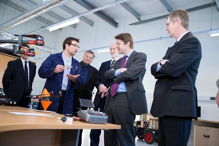 Visiting researcher Jonathan Gill discusses agricultural drones with the Minister