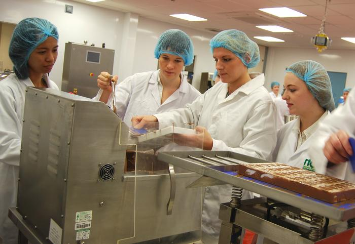 Becca and other food students making chocolates