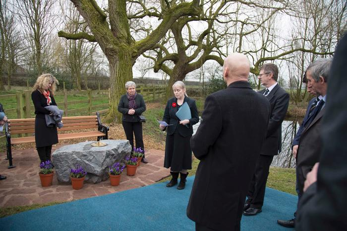 Alumni officer Julie Brook reads a few words at the memorial garden