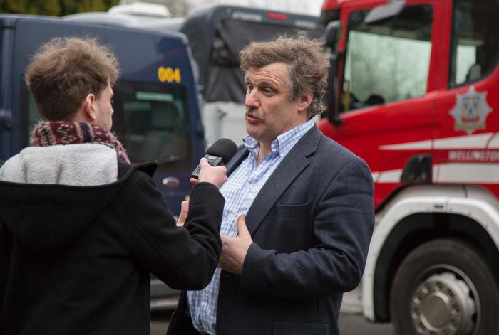 Senior lecturer Alan Stewart discusses the training with a local BBC radio reporter