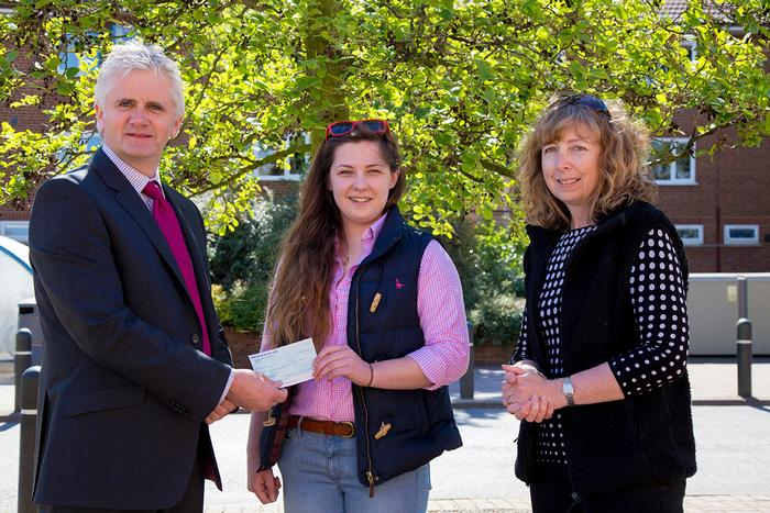 Hannah Clarke receives the Acorus prize from Anthony Atkinson and Emma Pierce-Jenkins