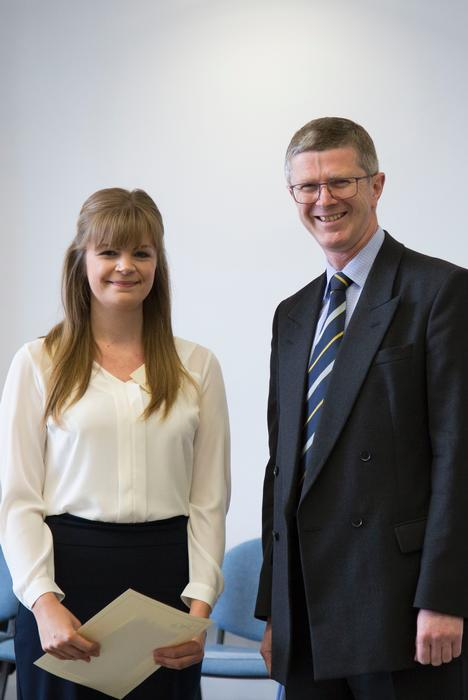 Catherine Waldron is congratulated by Vice-Chancellor Dr David Llewellyn