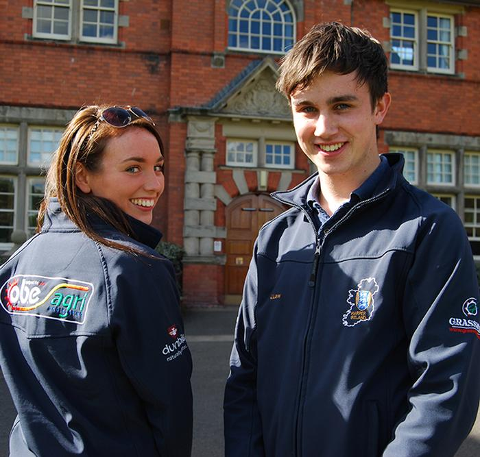 Chairman James Law and fellow committee member Anna Carmichael model new Harper Ireland jackets bearing the sponsors' logos