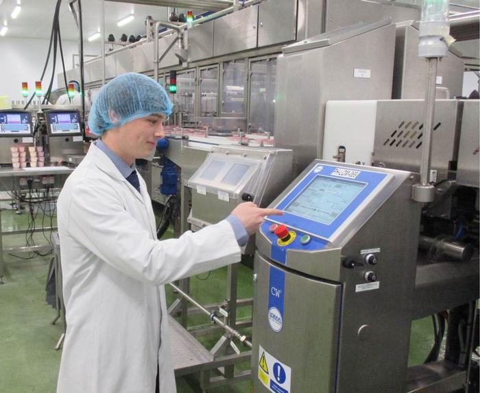 Jacob at work in the dairy at Yeo Valley, Somerset