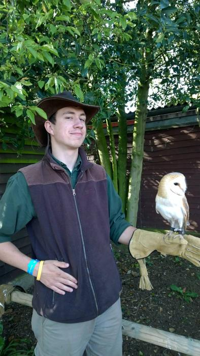 Andrew with a rescued owl at Cuan Wildlife Rescue
