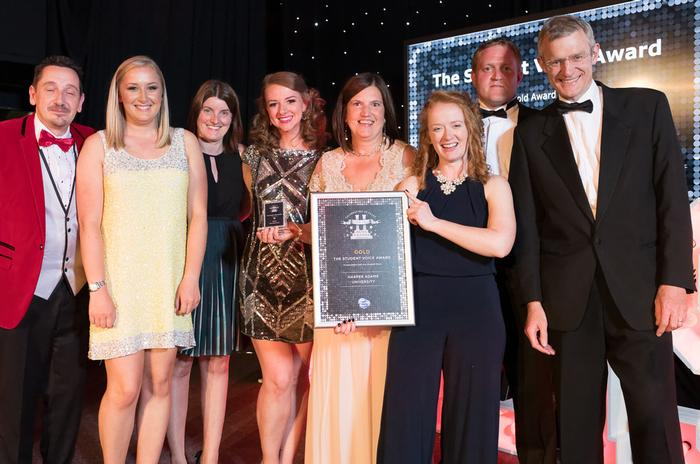The Harper Adams team collect the Gold Student Voice Award at Heist 2015