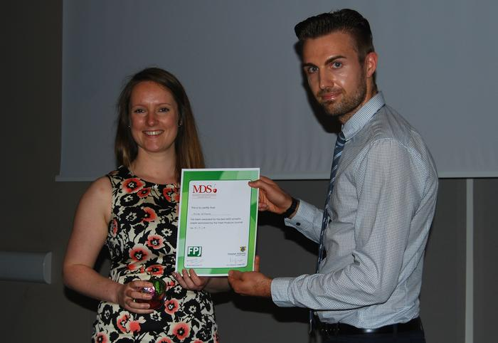 Group 32 Best Synpotic Paper winner, Anna Williams with Martyn Fisher from the FPJ