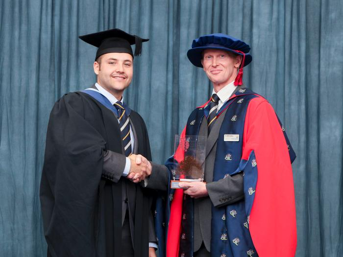 Damien Burnell receives the British Society for Soil Science Undergraduate Award from Dr William Hartley