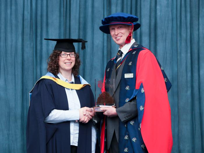 Nichola Taylor receives the British Society for Soil Science Postgraduate Award from Dr William Hartley