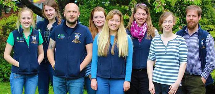 Sam, third from left, with conservation society students
