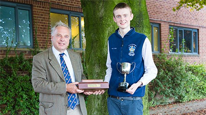Simon Keeble senior lecturer presenting the prizes to Harry Storey