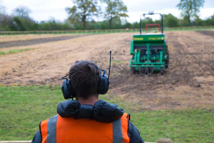 Jonathan Gill watching the autonomous tractor at work