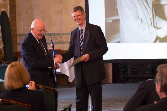Dr David Llewellyn receiving his Temperton Fellowship from Chairman Peel Holroyd